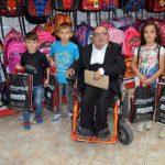 Engelli Genç 12 öğrenciye okul kıyafeti desteğinde bulundu